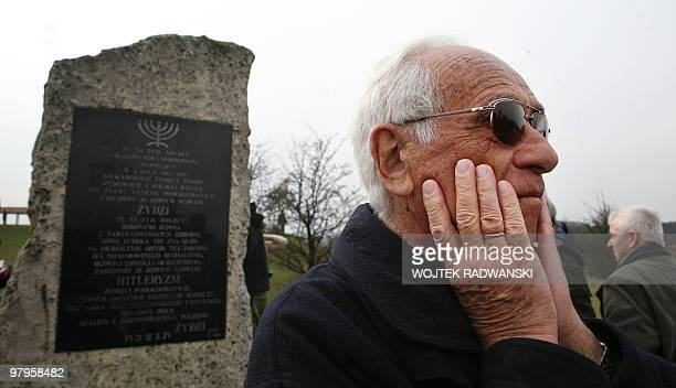 Jan Dresner a Jew saved from the Holocaust by German industrialist Oskar Schindler reacts opposite the memorial plaque in the former Nazi...