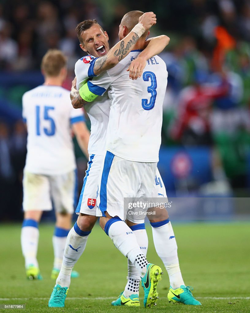 Jan Durica (L) and Martin Skrtel (R) of Slovakia celebrate the draw after the UEFA EURO 2016 Group B match between Slovakia and England at Stade Geoffroy-Guichard on June 20, 2016 in Saint-Etienne, France.