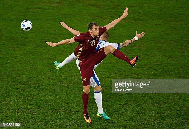 Jan Durica of Slovakia and Artem Dzyuba of Russia batlle for possesion during the UEFA EURO 2016 Group B match between Russia and Slovakia at Stade...