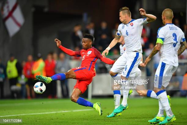 Jan Durica of Slovakia and Daniel Sturridge of England challenge for the ball during the preliminary round Group B match between Slovakia and England...