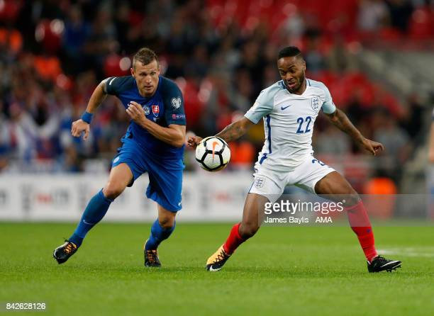 Jan Durica of Slovakia and Raheem Sterling of England during the FIFA 2018 World Cup Qualifier between England and Slovakia at Wembley Stadium on...