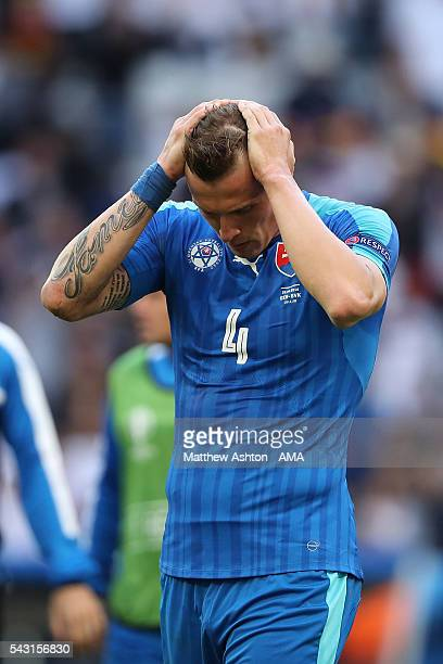Jan Durica of Slovakia looks dejected at the end of the UEFA Euro 2016 Round of 16 match between Germany and Slovakia at Stade PierreMauroy on June...