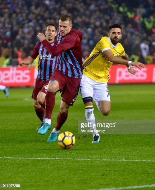 Jan Durica of Trabzonspor in action against Alper Potuk of Fenerbahce during a Turkish Super Lig match between Trabzonspor and Fenerbahce at Medical...