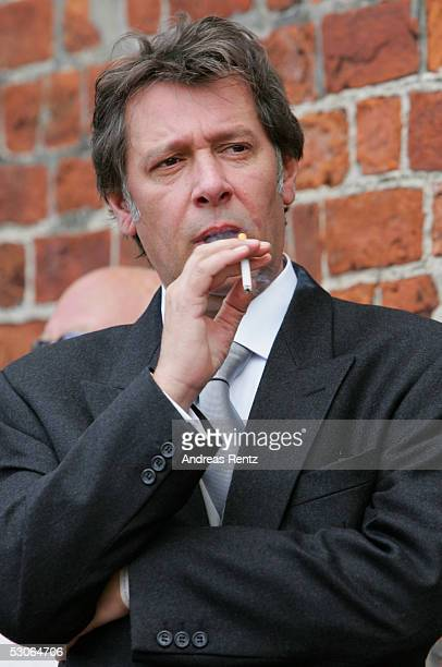 Jan Fedder actor smokes a cigarette at the Sankt Severin church on June 11 2005 at Sylt in Germany Michael Stich and Alexandra Rikowski celebrates...