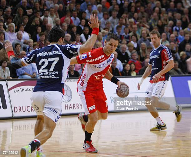 Jan Filip of Nordhorn is challenged by Alexander Petersson of Flensburg during the Bundesliga Handball game between SG FlensburgHandewitt and HSG...