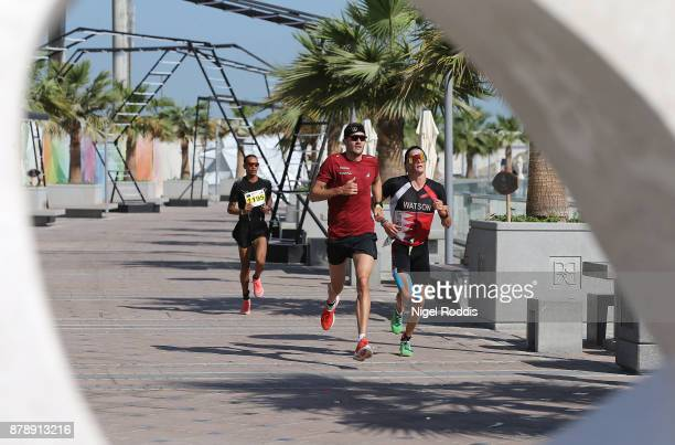 Jan Fredeno of Germany competes in the run section of Ironman 703 Middle East Championship Bahrain on November 25 2017 in Bahrain Bahrain