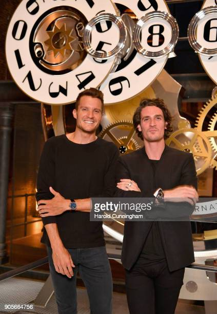 Jan Frodeno and Patrick Seabase visit the IWC booth during the Maison's launch of its Jubilee Collection at the Salon International de la Haute...