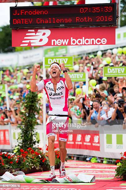 Jan Frodeno of Germany celebrates as he wins Challenge Triathlon Roth and sets a new world record on July 17 2016 in Roth Germany