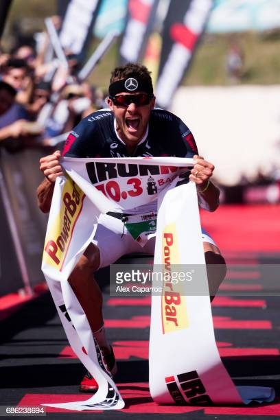 Jan Frodeno of Germany celebrates as he wins Ironman 703 Barcelona race on May 21 2017 in Barcelona Spain