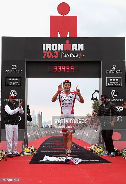 Jan Frodeno of Germany celebrates winning the Men's IRONMAN 703 Dubai on January 29 2016 in Dubai United Arab Emirates