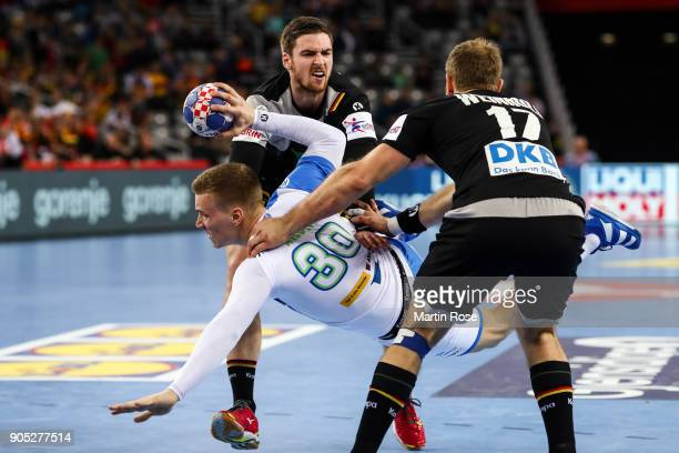 Jan Grebenc of Slovenia is challenged by Hendrik Pekeler of Germany and Steffen Weinhold of Germany during the Men's Handball European Championship...