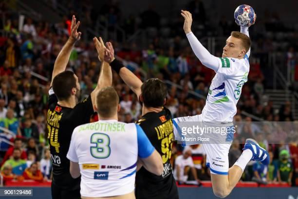 Jan Grebenc of Slovenia tries to score over Milos Bozovic of Montenegro and Vladan Lipovina of Montenegro during the Men's Handball European...