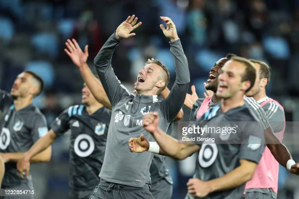 Jan Gregus of Minnesota United celebrates with teammates after the victory against Vancouver Whitecaps at Allianz Field on May 12, 2021 in St Paul,...