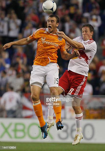 Jan Gunnar Solli of the New York Red Bulls battles for the ball against Cam Weaver of the Houston Dynamo at Red Bull Arena on May 9 2012 in Harrison...