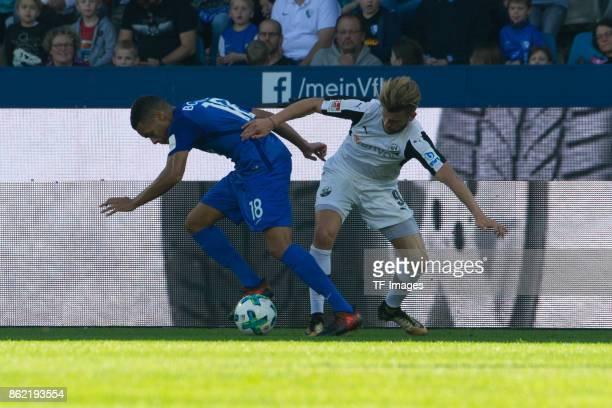 Jan Gyamerah of Bochum and Lucas Hoeler of Sandhausen battle for the ball during the Second Bundesliga match between VfL Bochum 1848 and SV...