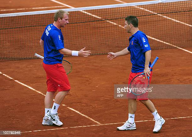 Jan Hajec and Lukas Dlouhy celebrate a point during their Davis Cup quarterfinal doubles match against Nicolas Massu and Jorge Aguilar of Chile in La...