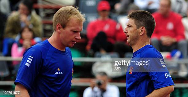 Jan Hajec and Lukas Dlouhy of Czech Republic play against Chilean Nicolas Massu and Jorge Aguilar during their Davis Cup quarterfinal doubles match...