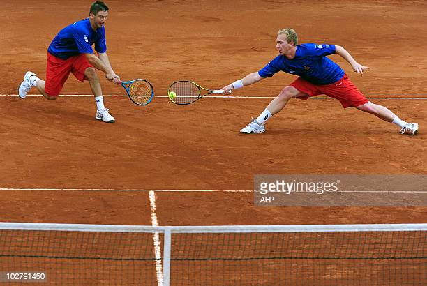 Jan Hajec and Lukas Dlouhy of Czech Republic return a ball to Chilean Nicolas Massu and Jorge Aguilar during their Davis Cup quarterfinal doubles...
