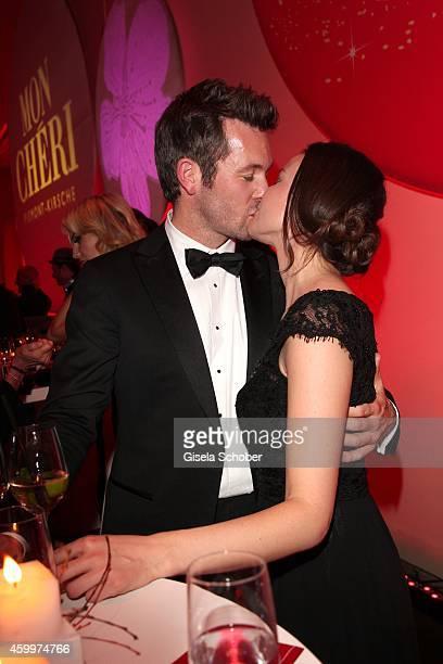 Jan Hartmann kissing his girlfriend Julia during the Mon Cheri Barbara Tag 2014 at Haus der Kunst on December 4 2014 in Munich Germany