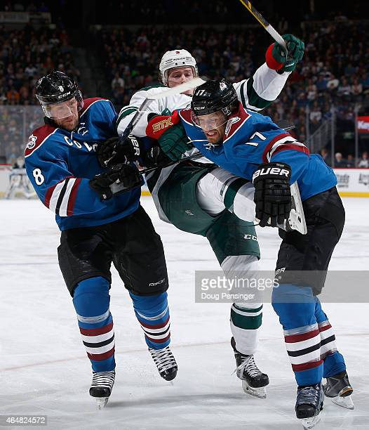 Jan Hejda and Brad Stuart of the Colorado Avalanche defend against Charlie Coyle of the Minnesota Wild at Pepsi Center on February 28 2015 in Denver...