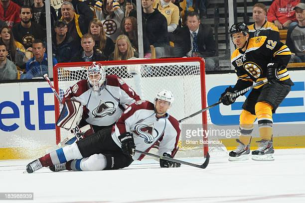 Jan Hejda and JeanSebastian Giguere of the Colorado Avalanche try to block the shot against the Boston Bruins at the TD Garden on October 10 2013 in...
