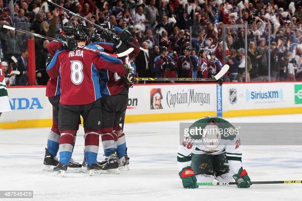 Jan Hejda and other members of the Colorado Avalanche celebrate a goal as Matt Moulson of the Minnesota Wild reacts in Game Seven of the First Round...