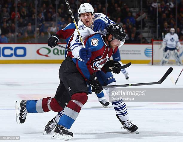 Jan Hejda of the Colorado Avalanche and James van Riemsdyk of the Toronto Maple Leafs collide during action at Pepsi Center on January 21 2014 in...