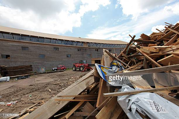 Jan Hennop Wood is piled up by the 150 metrelong Noah's ark created by Dutch Johan Huibers in Dordrecht on June 21 2011 For the last three years the...
