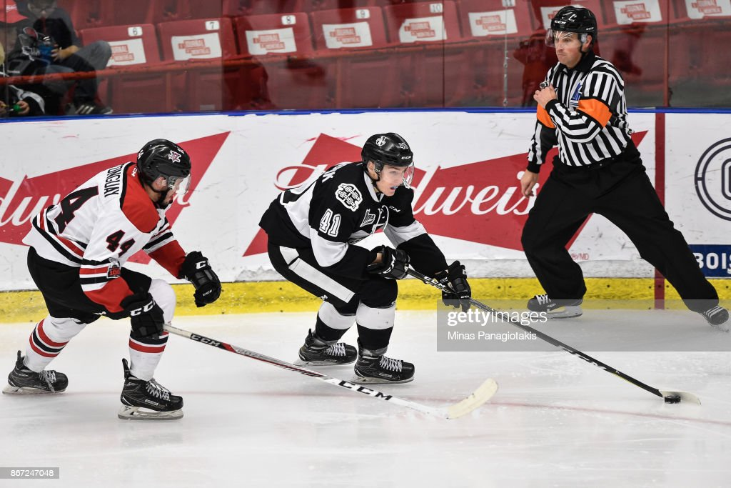 Jan Hladonik #41 of the Blainville-Boisbriand Armada skates the puck against Daven Castonguay #44 of the Drummondville Voltigeurs during the QMJHL game at Centre d'Excellence Sports Rousseau on October 27, 2017 in Boisbriand, Quebec, Canada. The Blainville-Boisbriand Armada defeated the Drummondville Voltigeurs 2-0.