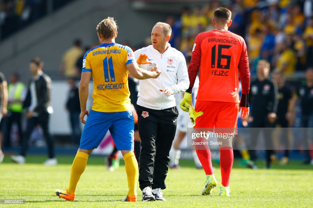 Jan Hochscheidt Coach Torsten Lieberknecht and Jasmin Fejzic of Braunschweig after the Second Bundesliga match between Eintracht Braunschweig and Karlsruher SC at Eintracht Stadion on May 21, 2017 in Braunschweig, Germany.