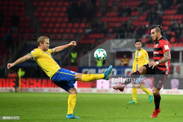 Jan Hochscheidt of Braunschweig and Dario Lezcano of Ingolstadt compete for the ball during the Second Bundesliga match between FC Ingolstadt 04 and...