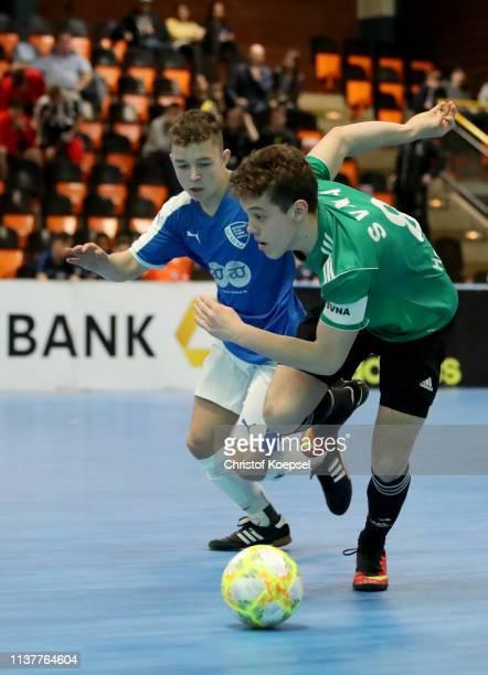 Jan Hoffmann of EGC Wirges challenges Mika Clausen of SV Nettelnburg Allermoehe during the B-Juniors first round match between SV Nettelnburg...