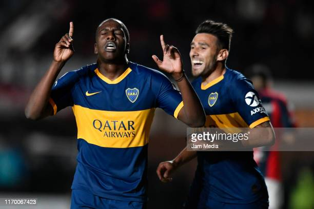 Jan Hurtado of Boca Juniors celebrates after scoring his side's second goal with teammate Eduardo Salvio during a match between San Lorenzo and Boca...
