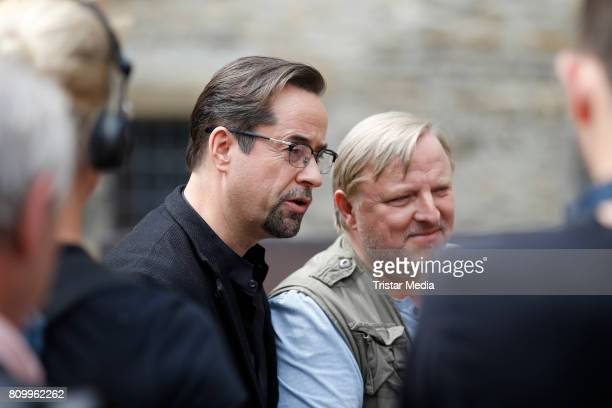 Jan Josef Liefers and Axel Prahl during the 'Tatort Gott ist auch nur ein Mensch' On Set Photo Call on July 5 2017 in Muenster Germany