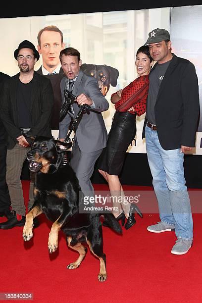 Jan Josef Liefers Wotan Wilke Moehring Jasmin Gerat and Marc Rothemund attend the 'Mann Tut Was Mann Kann' Germany Premiere at CineStar on October 9...