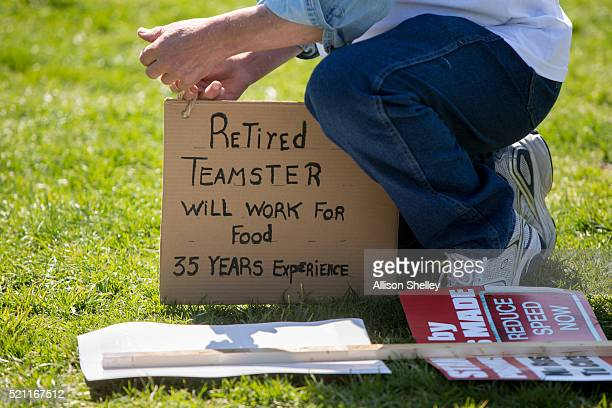 Jan Kacher of Deerfield Michigan adjusts a sign as he rallies on the West Front of the US Capitol building with fellow Teamsters Union retirees who...