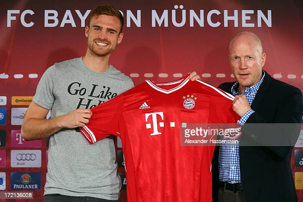 Jan Kirchhoff of FC Bayern Muenchen presents his new match jersey with sporting director Matthias Sammer after a press conference at Bayern Muenchens...