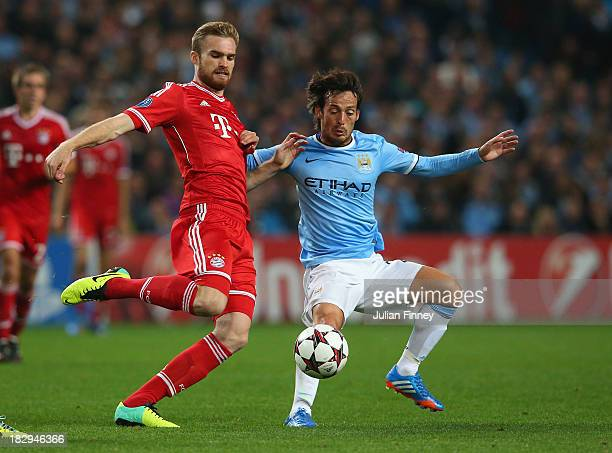 Jan Kirchhoff of Muenchen battles with David Silva of Manchester City during the UEFA Champions League Group D match between Manchester City and FC...