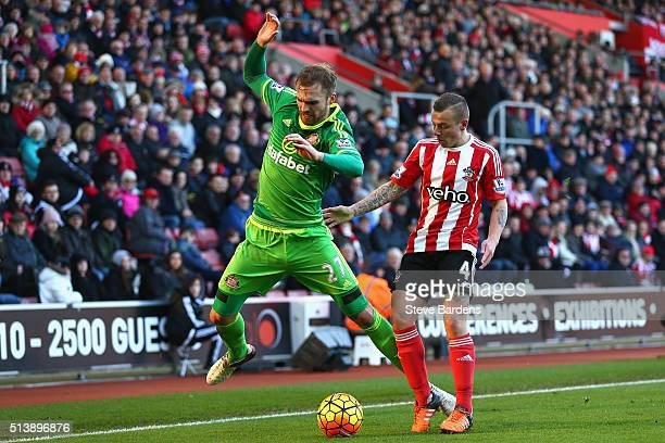 Jan Kirchhoff of Sunderland and Jordy Clasie of Southampton compete for the ball during the Barclays Premier League match between Southampton and...