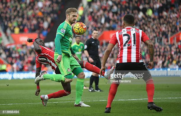 Jan Kirchhoff of Sunderland and Sadio Mane of Southampton compete for the ball during the Barclays Premier League match between Southampton and...