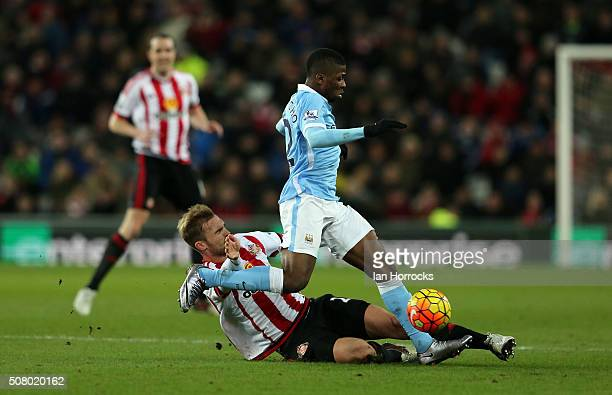 Jan Kirchhoff of Sunderland tackles Kelechi Iheanacho of Manchester City during the Barclays Premier League match between Sunderland and Manchester...