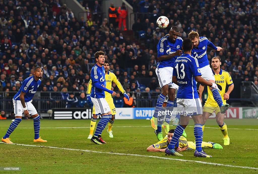 Jan Kirchoff of Schalke (2R) scores an own goal for Chelsea's thrid during the UEFA Champions League Group G match between FC Schalke 04 and Chelsea FC at Veltins-Arena on November 25, 2014 in Gelsenkirchen, Germany.
