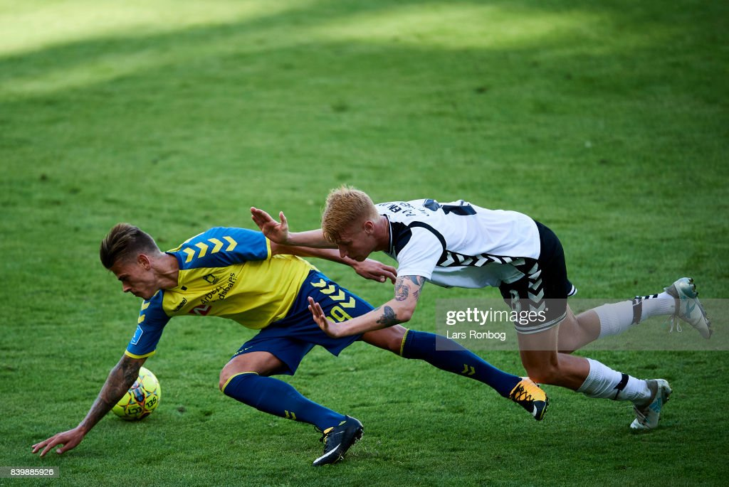 Jan Kliment of Brondby IF and Bjarke Jacobsen of AC Horsens compete for the ball during the Danish Alka Superliga match between Brondby IF and AC Horsens at Brondby Stadion on August 27, 2017 in Brondby, Denmark.