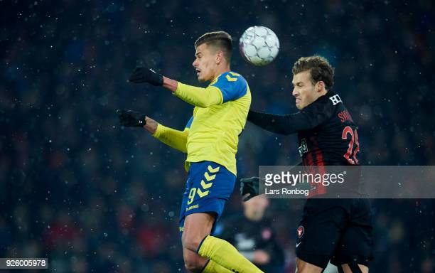 Jan Kliment of Brondby IF and Erik Sviatchenko of FC Midtjylland compete for the ball during the Danish Alka Superliga match between FC Midtjylland...