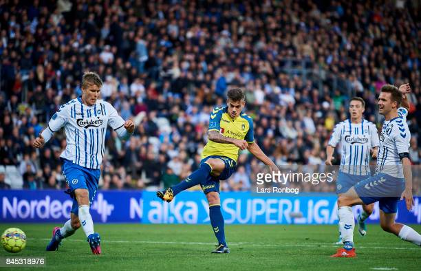 Jan Kliment of Brondby IF scores the 11 goal during the Danish Alka Superliga match between OB Odense and Brondby IF at EWII Park on September 10...