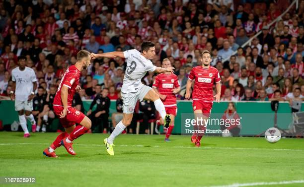 Jan Koch of Cottbus is challenged by Robert Lewandowski of Muenchen during the DFB Cup first round match between Energie Cottbus and FC Bayern...