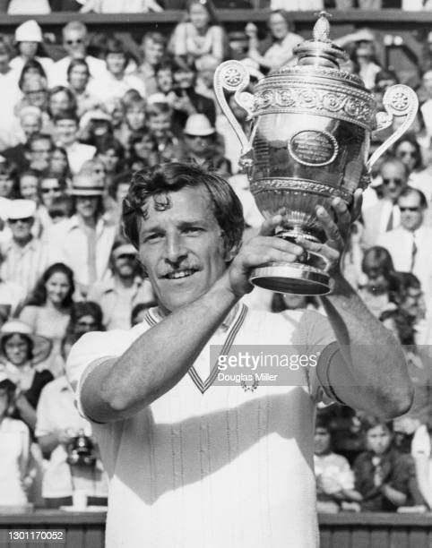 Jan Kodes of Czechoslovakia poses for photographs holding the Gentlemen's Singles Trophy after defeating Alex Metreveli of the Soviet Union in their...