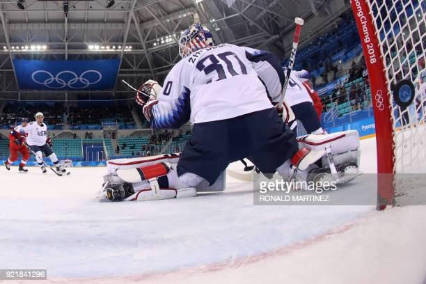 Jan Kolar , of the Czech Republic scores a goal in the nets of US goalkeeper Ryan Zapolski in the men's quarter-final ice hockey match between USA...