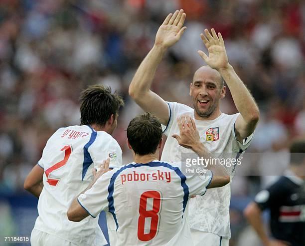 Jan Koller of Czech Republic celebrates with Karel Poborsky and Zdenek Grygera of Czech Republic after Tomas Rosicky scored the second goal during...