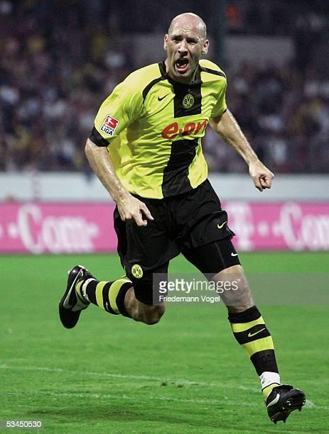 Jan Koller of Dortmund celebrates scoring the second goal during the DFB German Cup match between Eintracht Braunschweig and Borussia Dortmund at the...